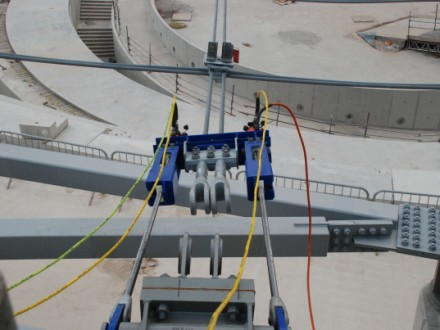 Tensioning roof cables during construction of the London 2012 Olympic Velodrome